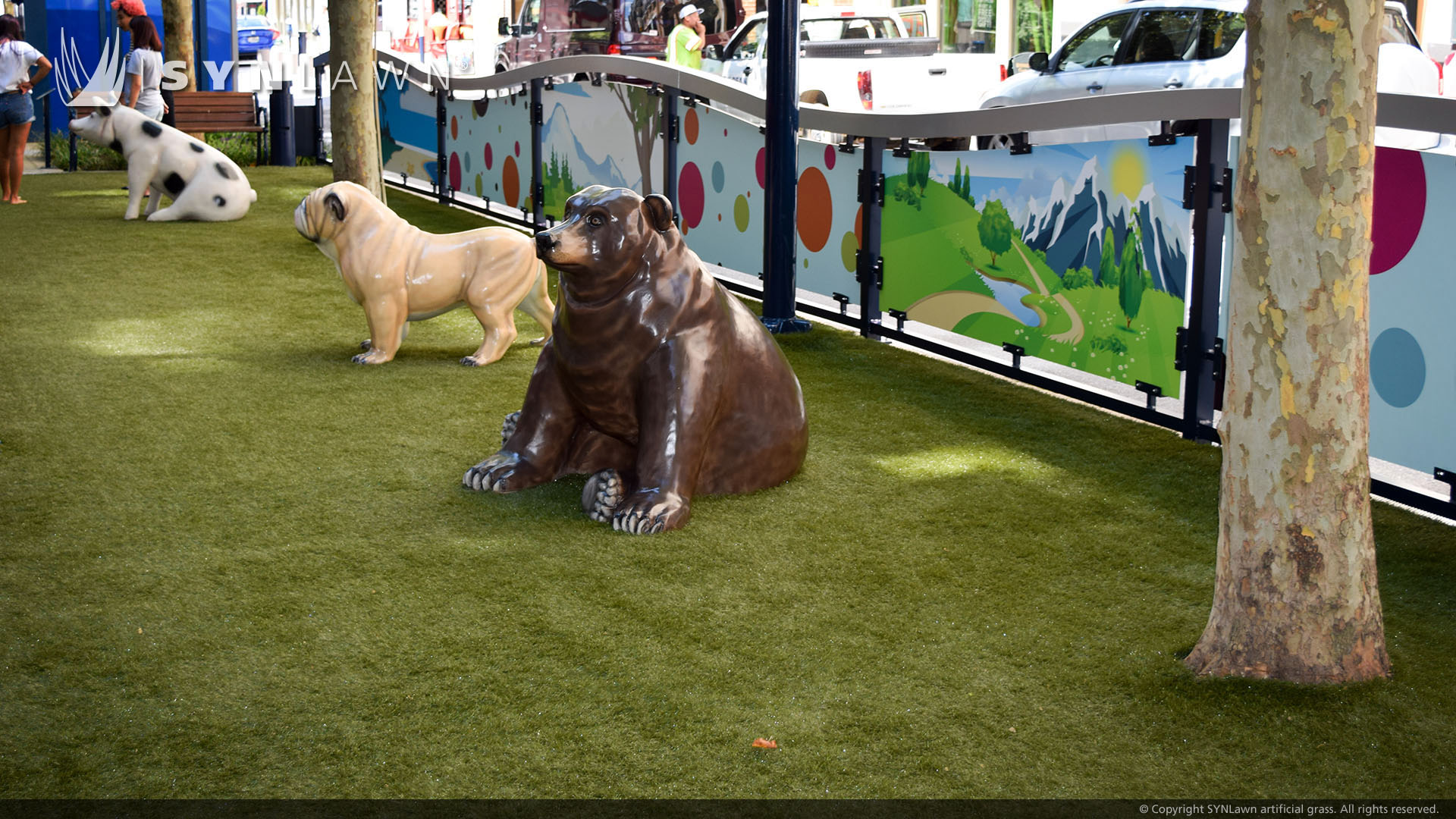: A Pig, Bulldog, and Bear are Part of a Fake Animal Exhibit Built on Synthetic Turf